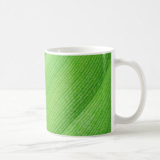 bright green young banana leaf coffee mug