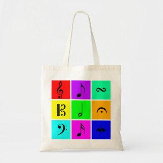 bright music symbols tote bags