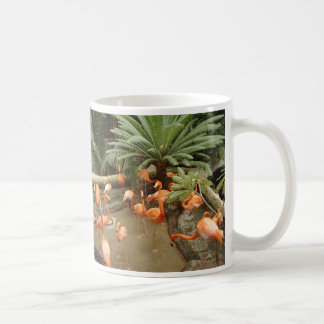 Bright pink flamingos in secluded tropical cove mug