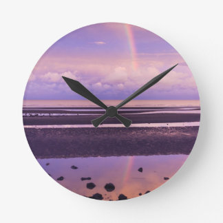 Bright Rainbow in a Purple and Pink Sunset Round Clock