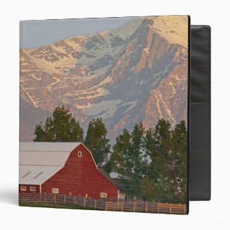 Bright red barn against Mission Mountains in 3 Ring Binder