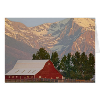 Bright red barn against Mission Mountains in Card