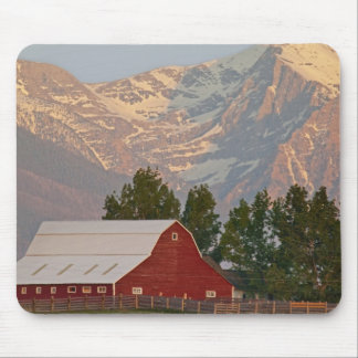 Bright red barn against Mission Mountains in Mouse Pad