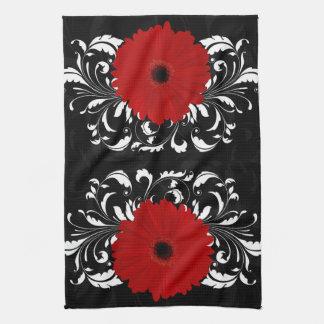 Bright Red Gerbera Daisy on Black Towel