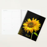 "Bright Sunflower on Black Background Planner<br><div class=""desc"">Bright yellow sunflower standing out in contrast to the black background creating a bold effect.</div>"