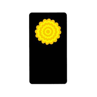 Bright sunny yellow flower. On Black. Label