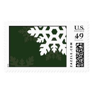 Bright, White Snowflakes against Dark Green Postage Stamp