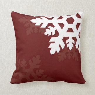 Bright, White Snowflakes against Dark Red Throw Pillow