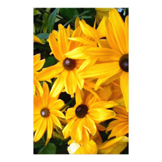 bright yellow flowers growing in the wild stationery
