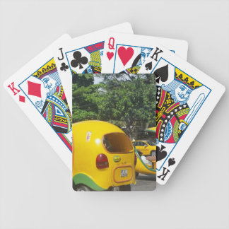 Bright yellow fun coco taxis from Cuba Bicycle Playing Cards