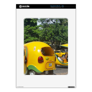 Bright yellow fun coco taxis from Cuba iPad Decal