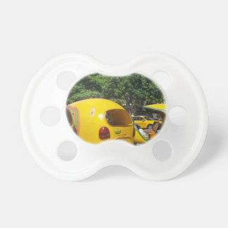 Bright yellow fun coco taxis from Cuba Pacifier