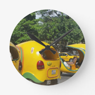 Bright yellow fun coco taxis from Cuba Round Clock