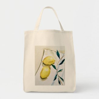 bright yellow lemons with herbs for cooking tote bag