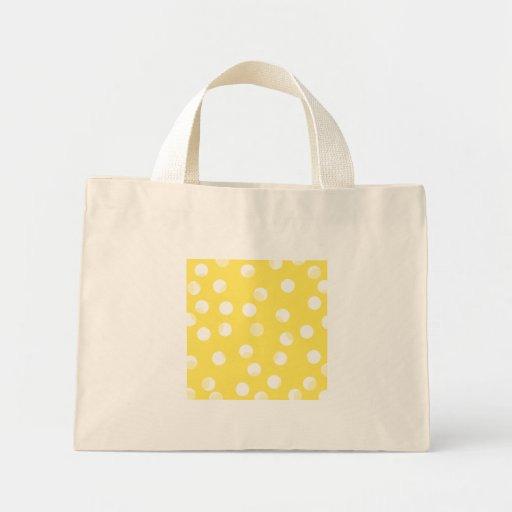 Bright yellow, light yellow, white spotty pattern. tote bag
