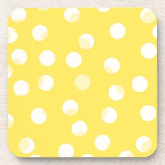 Bright yellow, light yellow, white spotty pattern. coaster