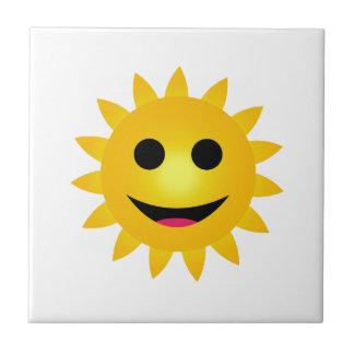Bright yellow sun smiling tile