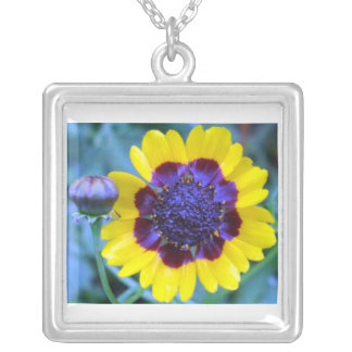 Bright yellow with blue center flower necklace