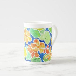 Brightly Coloured Nasturtiums Flowers on Blue Tea Cup