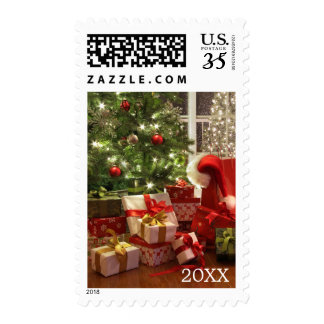 Brightly lit christmas tree with lots of gifts postage