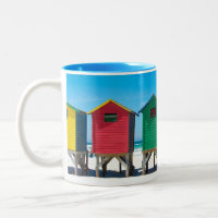 Brightly painted beach huts coffee mug