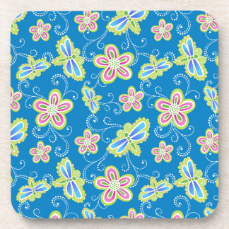 Brillant flowers, dragonflies and swirls on blue drink coaster