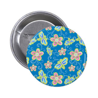 Brillant flowers, dragonflies and swirls on blue pinback button