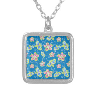 Brillant flowers, dragonflies and swirls on blue silver plated necklace