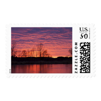 Brilliant sunset reflects into the Calamus River Postage