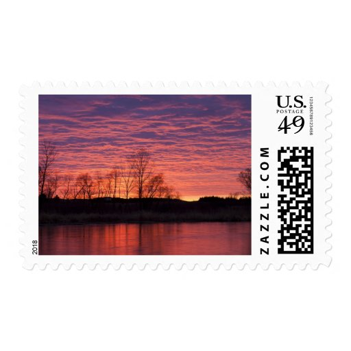 Brilliant sunset reflects into the Calamus River Postage Stamps