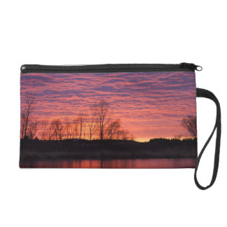 Brilliant sunset reflects into the Calamus River Wristlet