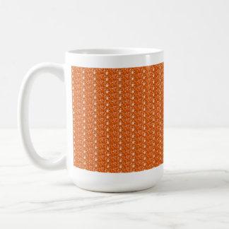Brillo anaranjado de la taza