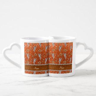 Brillo anaranjado de las estrellas de hadas de taza para parejas
