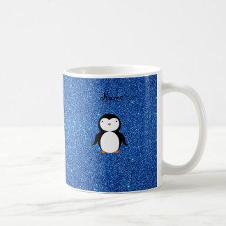 Brillo azul personalizado del pingüino conocido taza de café