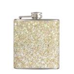 Brillo del oro en el frasco