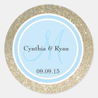Brillo del oro y etiqueta del monograma del boda