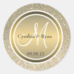 Brillo del oro y monograma de bronce metálico del pegatina redonda