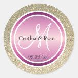 Brillo del oro y monograma púrpura metálico del etiqueta redonda