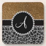 Brillo negro del oro del leopardo del monograma posavasos de bebidas