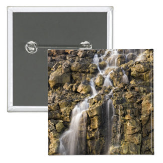 Brine falls from volcanic rock drop off pinback button