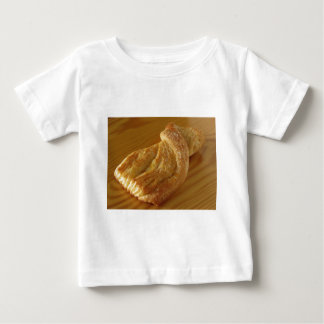 Brioche on a wooden table baby T-Shirt