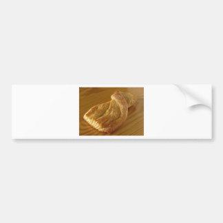 Brioche on a wooden table bumper sticker