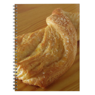 Brioche on a wooden table notebook