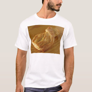 Brioche on a wooden table T-Shirt
