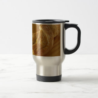 Brioche on a wooden table travel mug