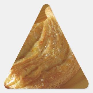 Brioche on a wooden table triangle sticker