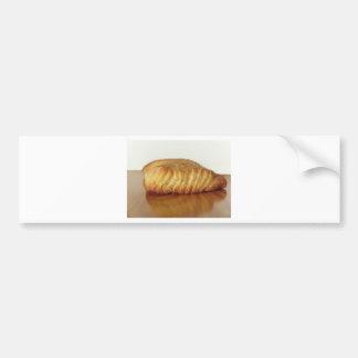 Brioche on a wooden table with granulated sugar bumper sticker