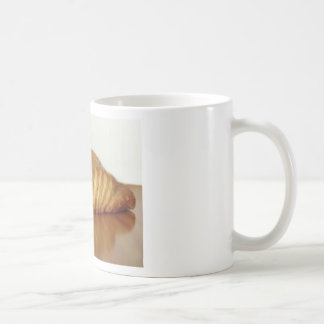 Brioche on a wooden table with granulated sugar coffee mug