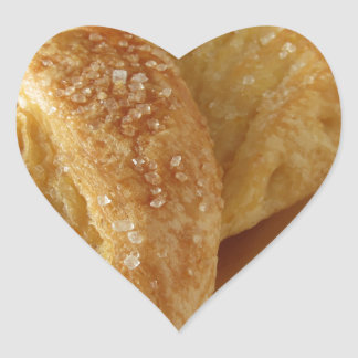 Brioche on a wooden table with granulated sugar heart sticker