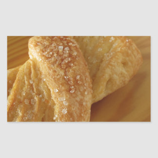 Brioche on a wooden table with granulated sugar rectangular sticker